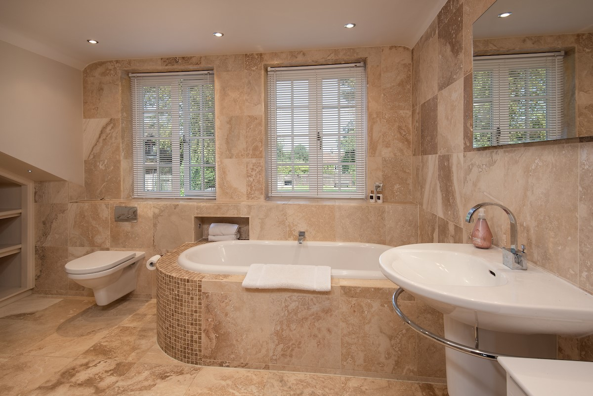 The en-suite master bedroom has a luxurious edge with a lavish bath tub for those who enjoy a good soak.
