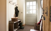 Old Granary House - bright entrance hall with coat hooks and storage for outdoor kit