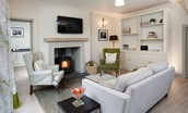 Crailing Coach House - seating area with fire