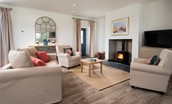 Lookout North - open plan sitting room with wood burning stove