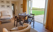 Fenton Lodge - dining table by patio doors