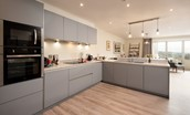 Old Granary House - beautifully modern open-plan kitchen with granite work surfaces overlooking the dining area