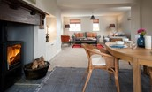 Farm Cottage - characterful fireplace with open plan dining and living space