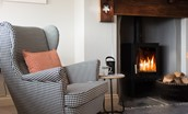 Farm Cottage - enjoy an armchair by the wood burning stove