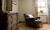 Old Granary House - armchair and large chest of drawers in bedroom two