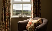 Old Granary House - armchair in bedroom one to sit back and enjoy the wonderful views of rolling Northumbrian countryside