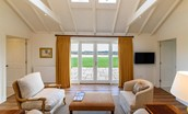 Fenton Lodge - living area with patio doors