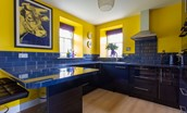 Lowtown Cottage - kitchen with sleek blue integrated cabinets