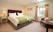 Old Granary House - bedroom one with zip and link beds, configured as a super king double or twin