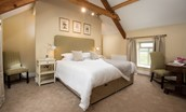 The Granary - bedroom two with beams