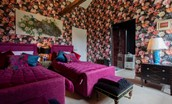 Lowtown Cottage - bedroom one with twin beds and dramatic floral wallpaper